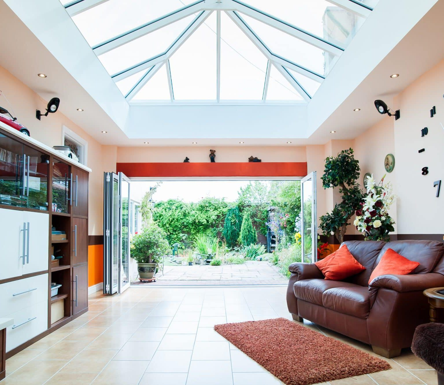 white atlas aluminium roofs with bifolding doors in an extension