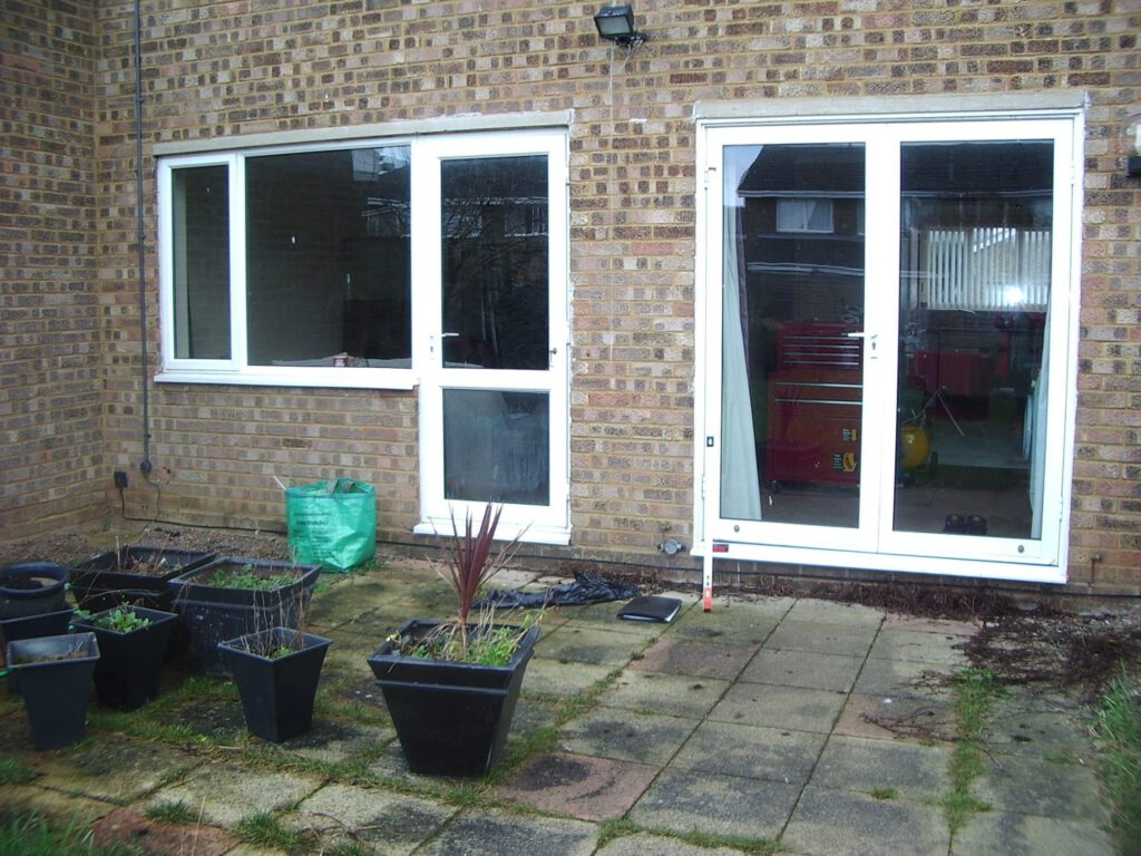 Old windows replaced with alufold warmcore bifolding doors.