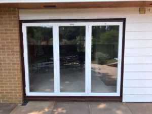 Alufold warmcore bifolding doors with brown outer frame in Surrey house.