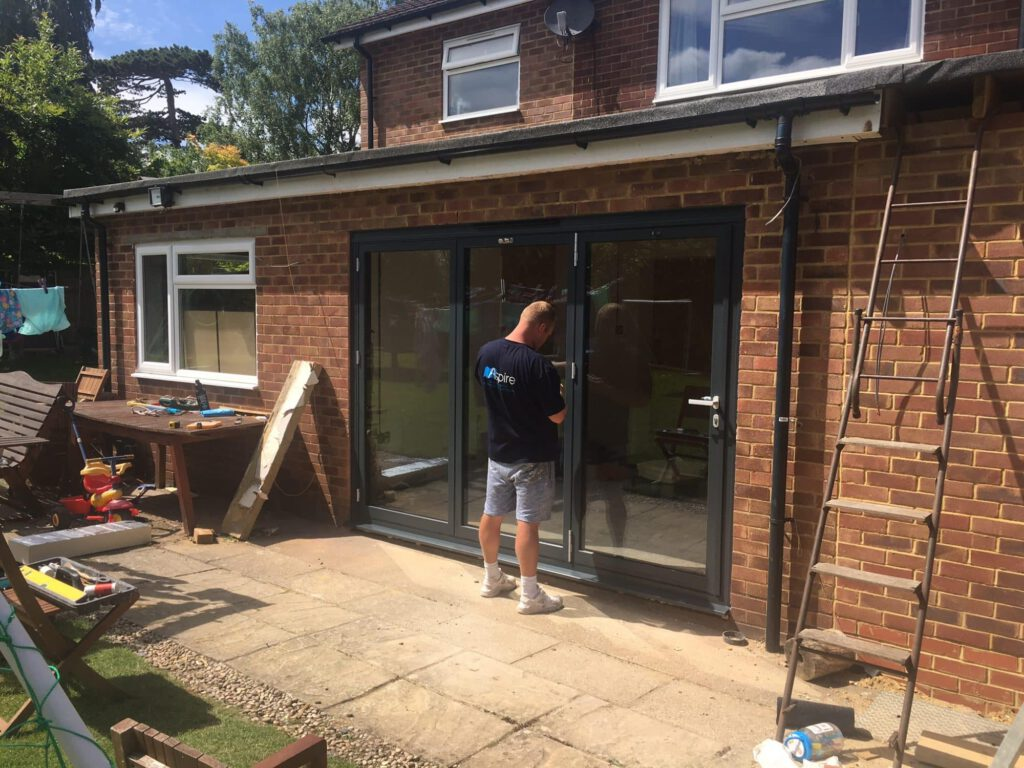 Schuco bifolds and flat rooflights to detached house in surrey
