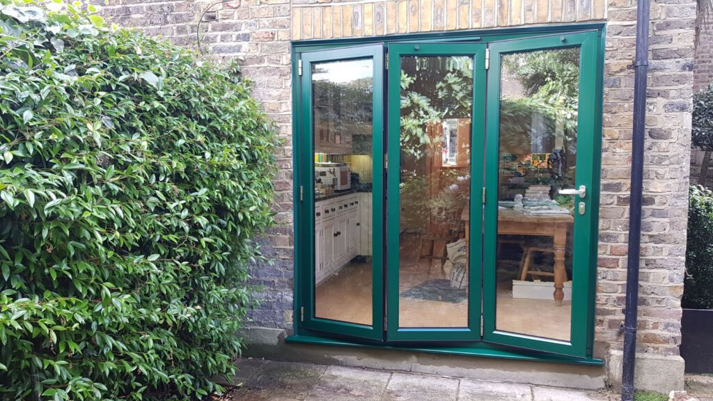 green bifolding doors fitted in london
