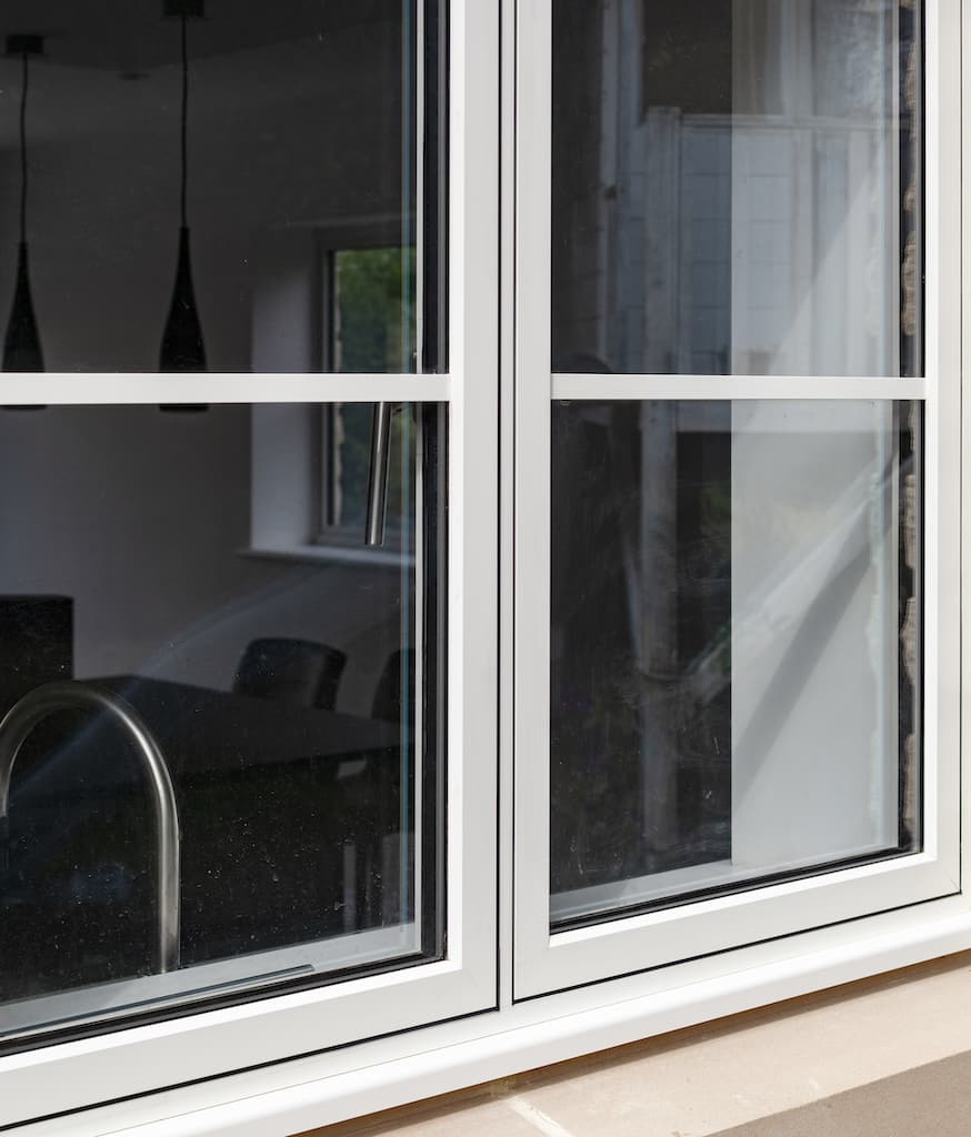 Alitherm 500 flush casement windows in a cream colour and cottage style
