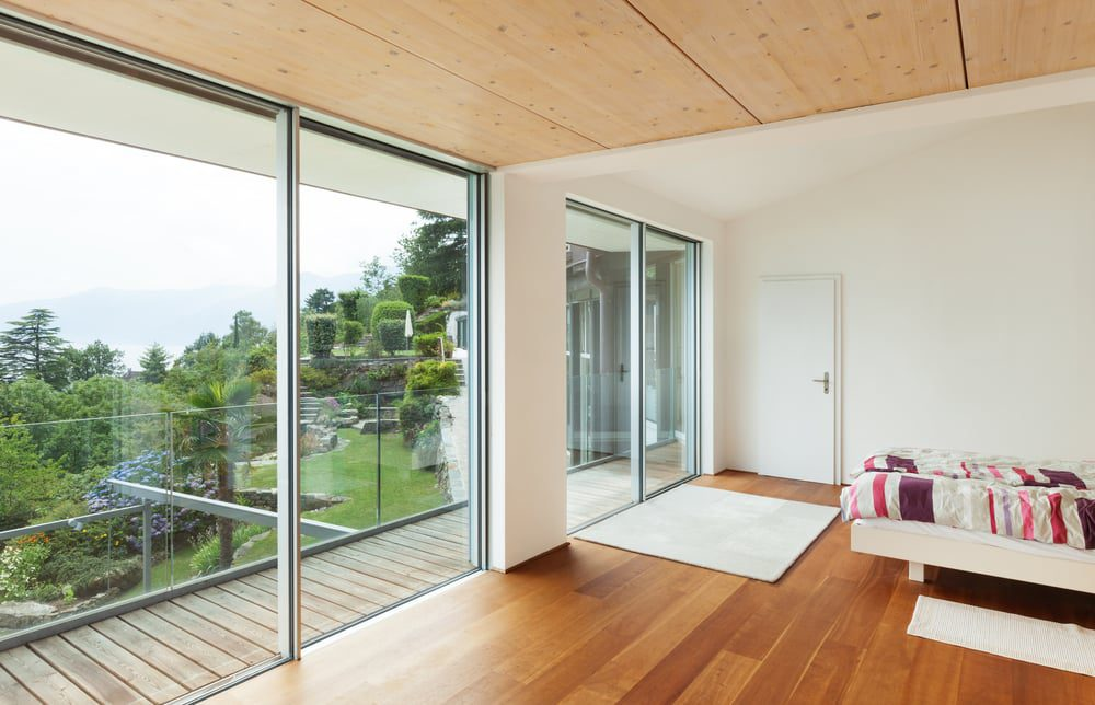 silver colour cortizo sliding doors in two sets on a balcony