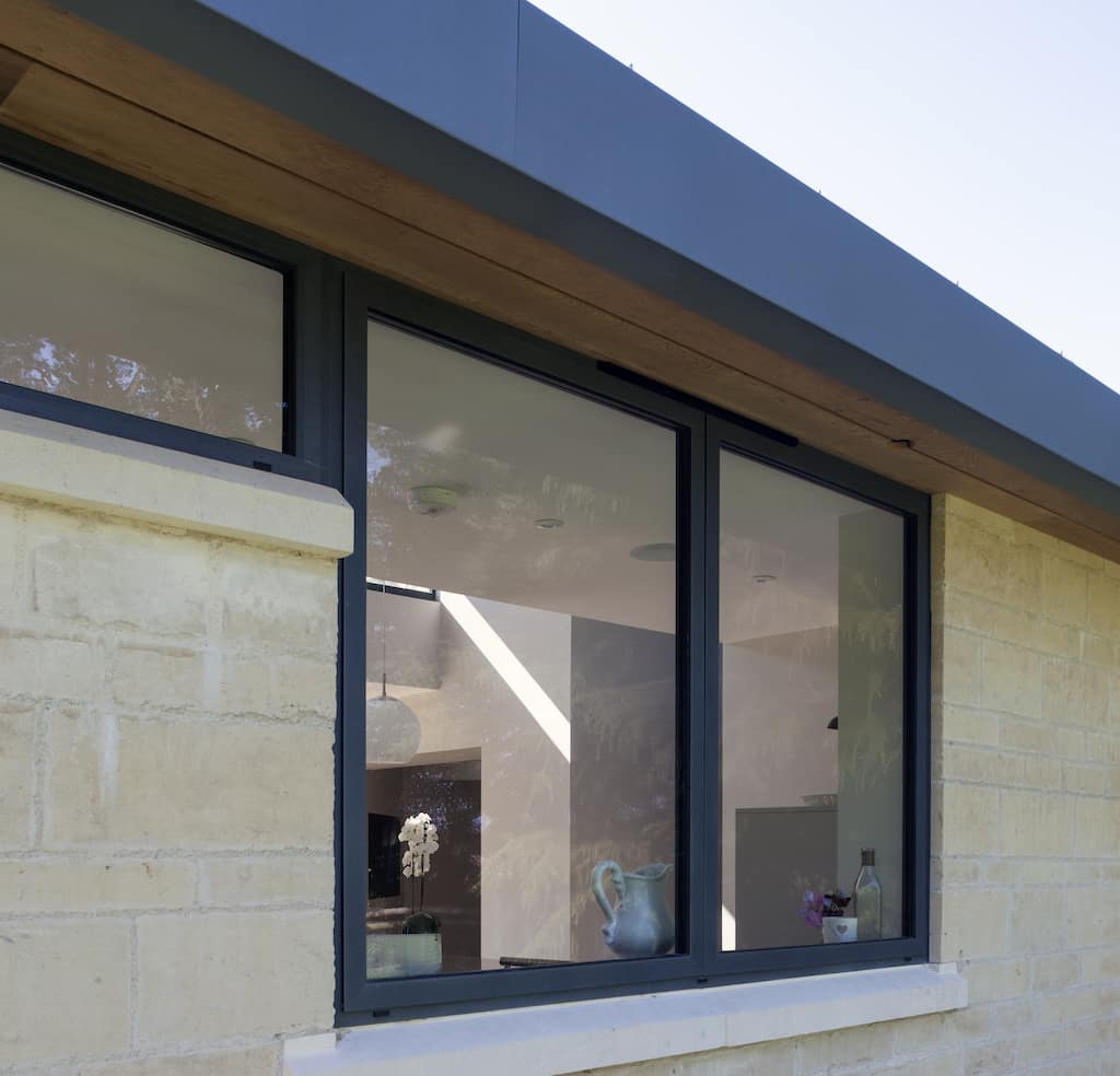 Alitherm 500 flush casement windows in modern grey colour to a kitchen