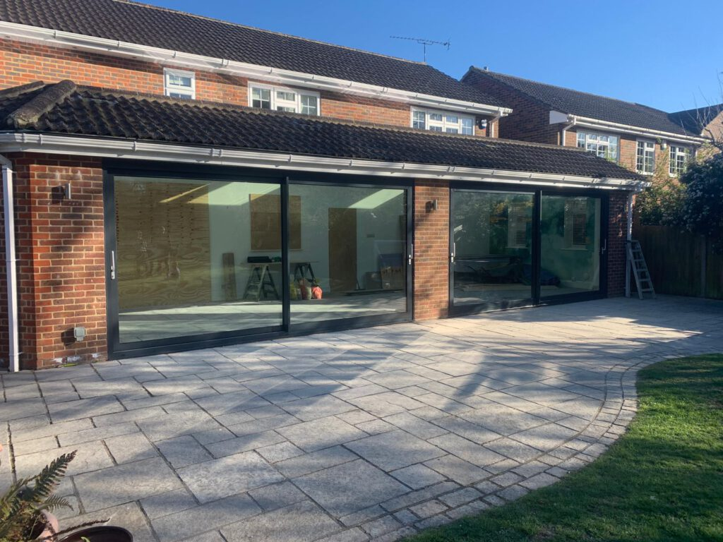 contemporary grey sliding doors at the back of a new build home